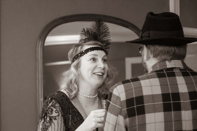 Couple in 1920s dress, lady smiling