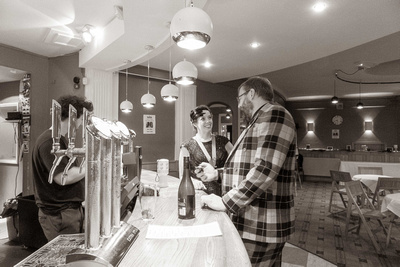 Couple being served at the Speakeasy Bar