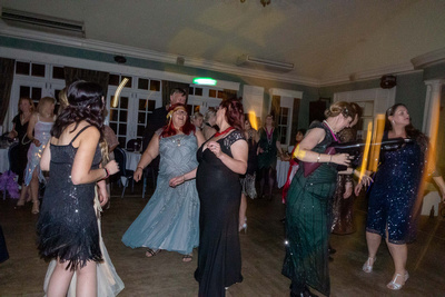 People dancing at a Speakeasy Gatsby themed party
