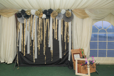 black, white, and gold backdrop with hamper of props for a photo funtography experience set